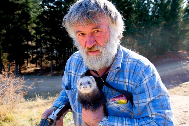 A ferret, gun and a beard